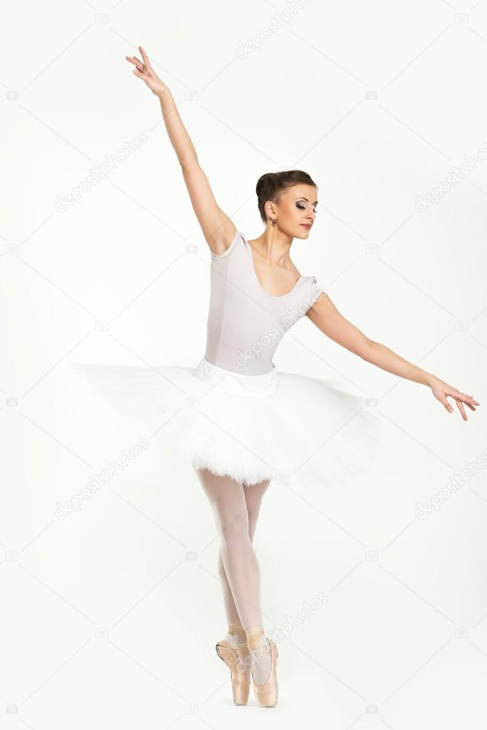 young ballerina dancer in tutu showing her techniques stock photo