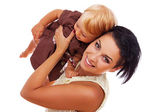 Portrét krásné ženy vystupují na bílém pozadí s dítětem