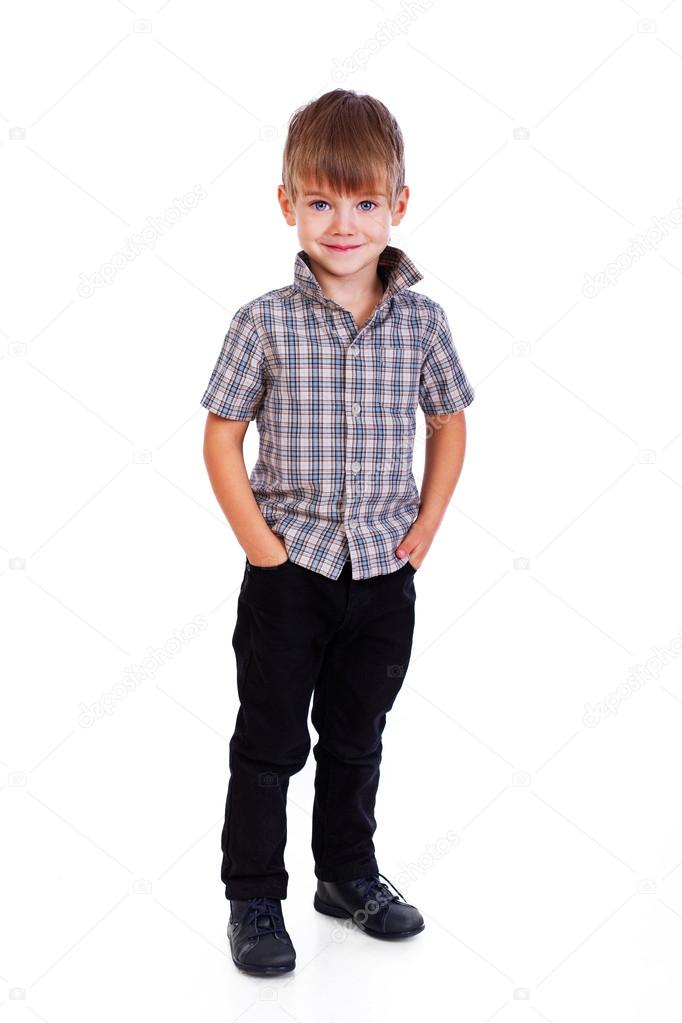 Portrait of little boy posing on white background