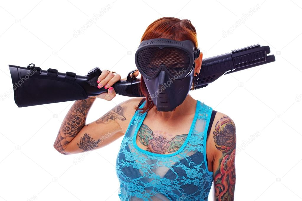 A young punk armed with a gun