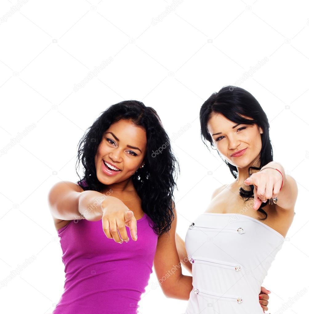 Portrait of 2 beautiful girl posing in studio