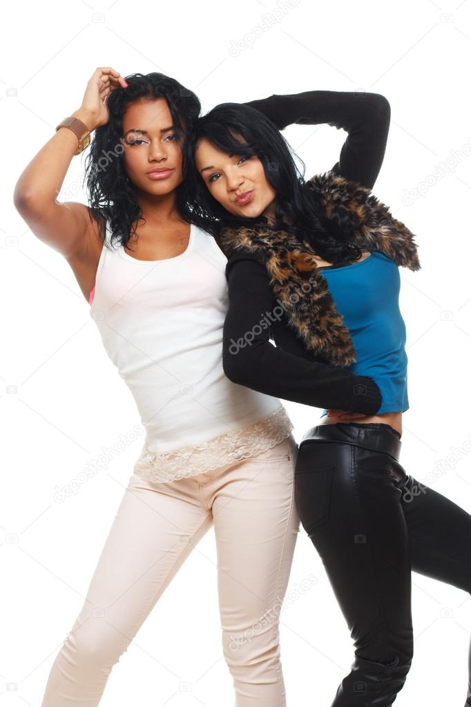 Portrait Of 2 Beautiful Girl Posing In Studio Stock Photo