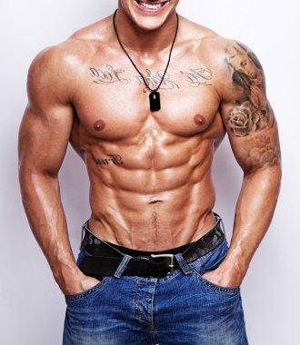 Portrait of sexy muscle man posing in studio