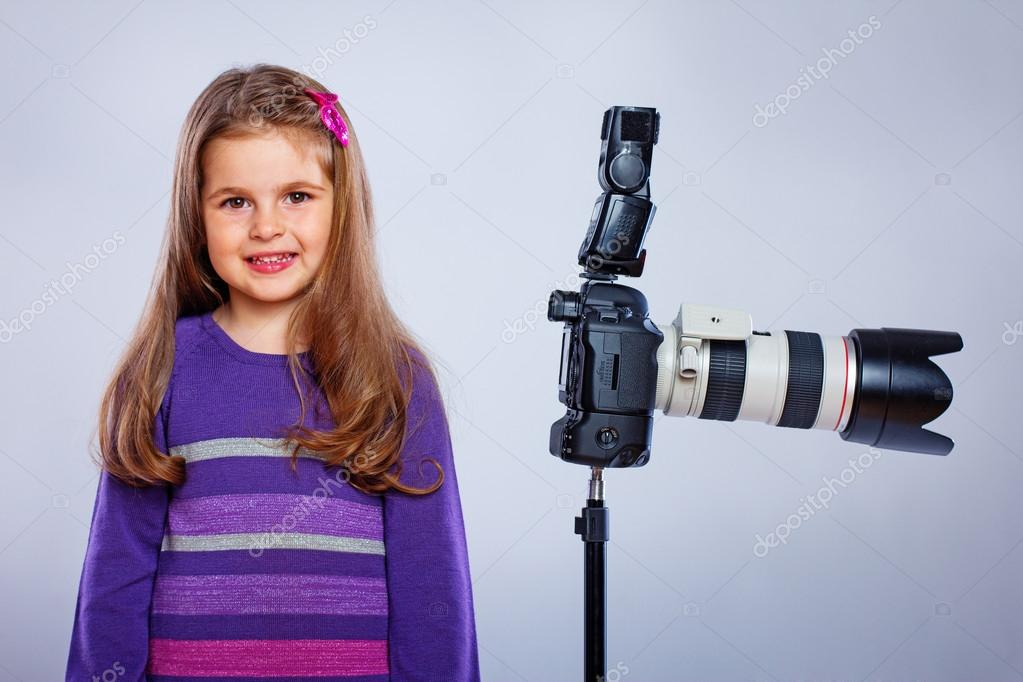 A kid posing with a camera