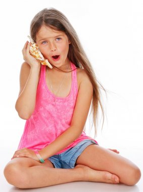 Little girl is fooling around with shell