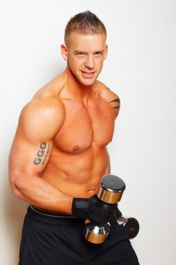 Hot shirtless guy with iron dumbbells