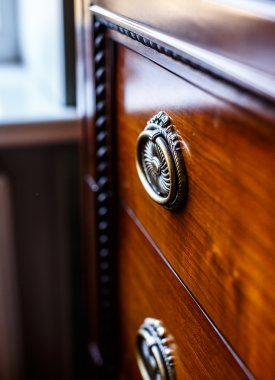Antique cupboard in front of window