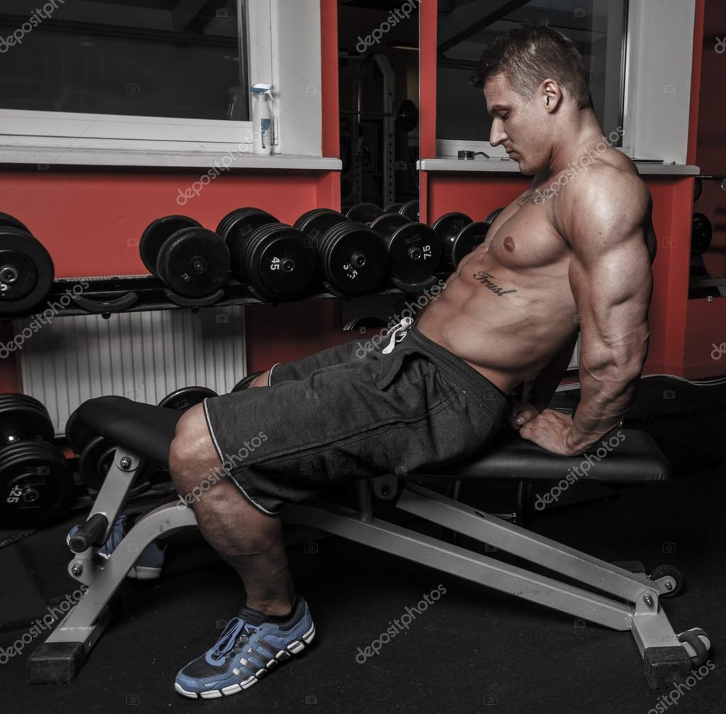 Sexy guy with well looking body is having rest