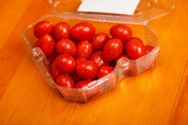Red cherry tomatoes in triangular container