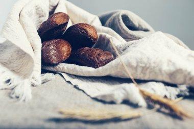 Dark loaves in light linen cloth