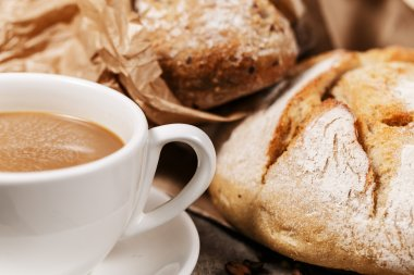 Rustic bread and a cup of milk coffee
