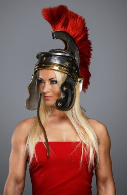 A blonde reenactress in a centurion headgear