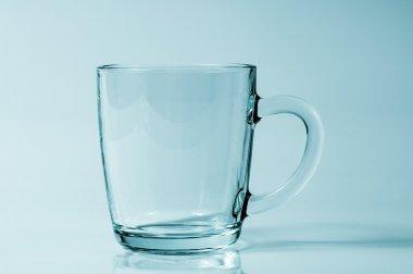 A transparent cup in a studio