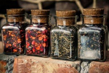 Four jars with loose leaf teas