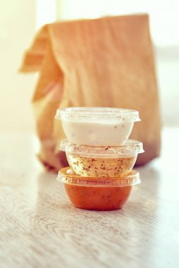 plastic containers with sauces