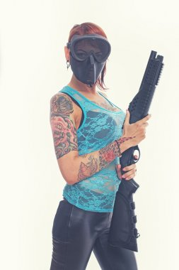 Girl with tattoo in mask
