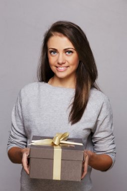 Young girl with a brown gift box
