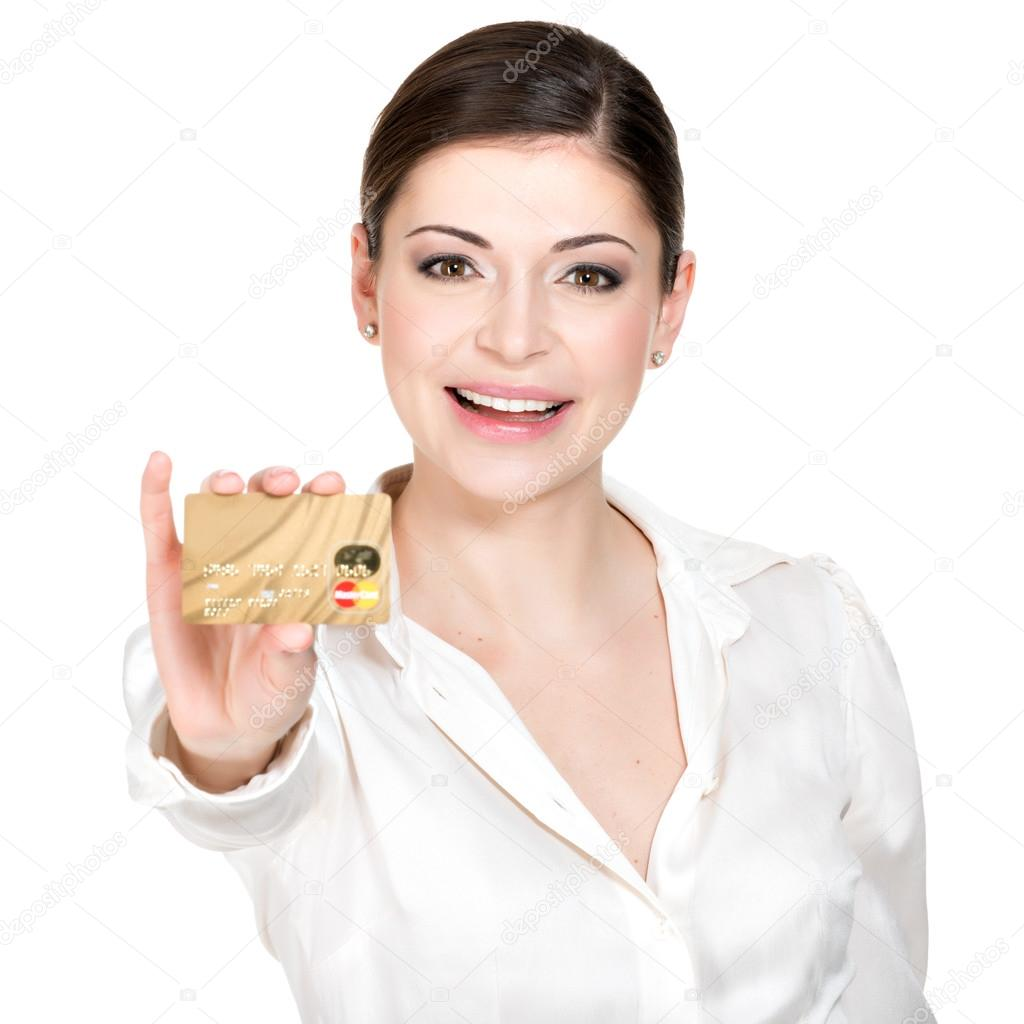 Portrait of smiling woman in a white shirt with credit card ...