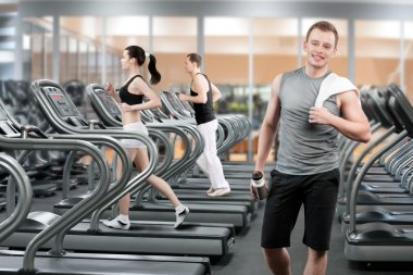 Young man in fitness club