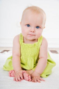 Baby girl in green dress