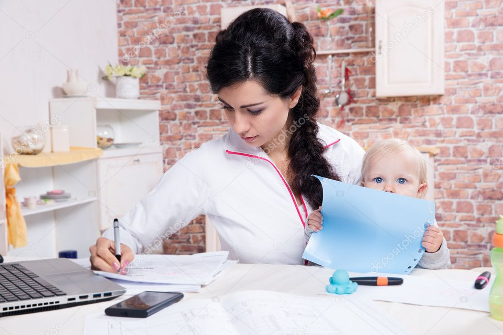 Woman With Baby Working From Home
