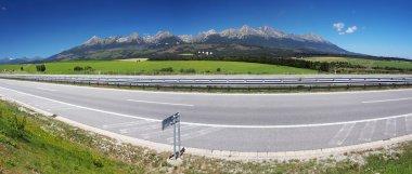 Panorama of highway and High Tatras