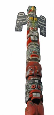Totem pole topped by thunderbird,