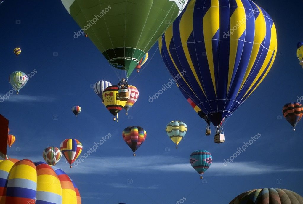 Tourists ride hot air balloons
