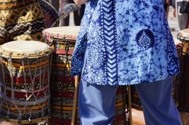 Drums played by women in brightly colored clothes