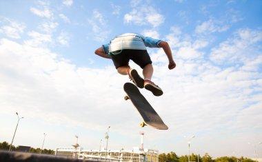 skateboarder over city