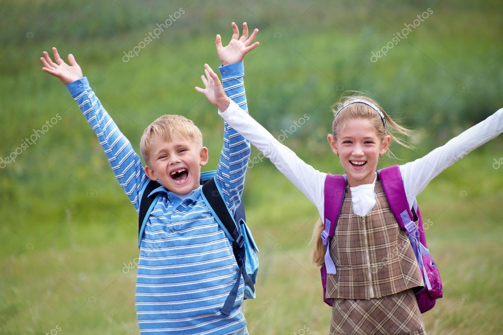 Portrait of boy with girl joyful laugh and throw their hands up