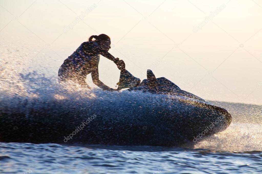 beautiful girl riding her jet skis