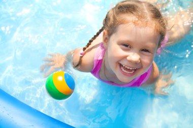 Happy little girl Swimming