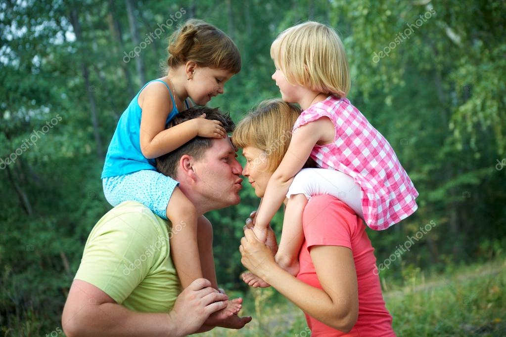 mom and dad with children