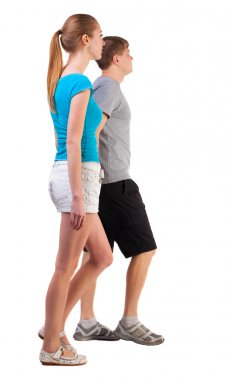 Back view of going young couple