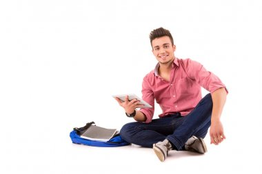 Young happy student working with a new digital tablet computer