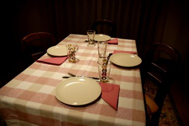 Dinner table ready to serve in a dark room