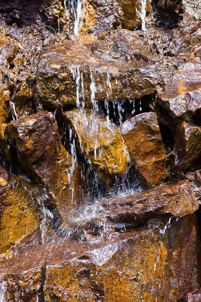 Waterfall on stones close, background