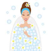 mladá žena si koupel s pěnou