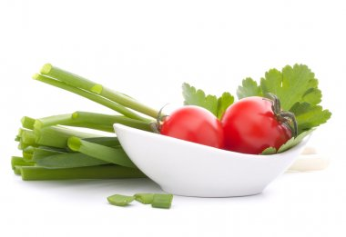 Spring onions and cherry tomato in bowl isolated on white background cutout stock vector