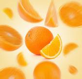 Fotografie flying sliced orange fruit segments