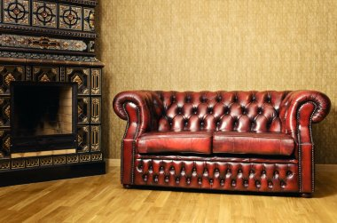 Sofa Near The Fireplace