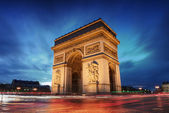 Fotografie Arc de triomphe Paris city at sunset