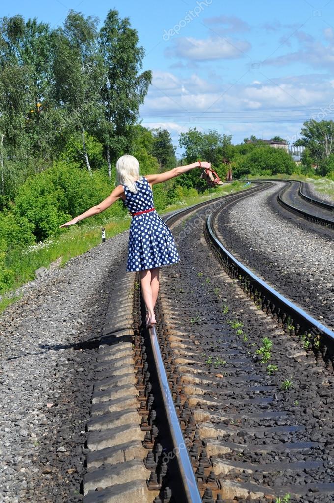 https://st.depositphotos.com/1002626/1812/i/950/depositphotos_18120521-stock-photo-woman-on-the-rail.jpg