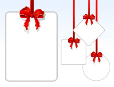 Card notes with red gift bows with ribbons.