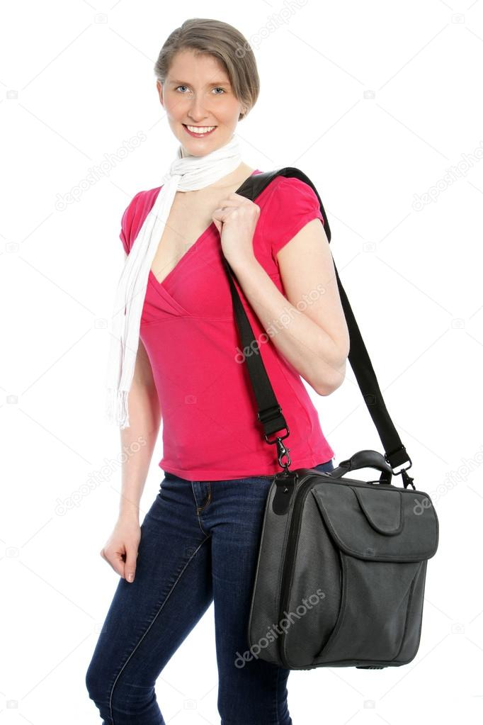 b7ebb70ddef4 Young attractive woman carrying a laptop shoulder bag smiling at the camera.