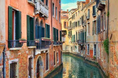 Small canal among old houses. Venice, Italy.
