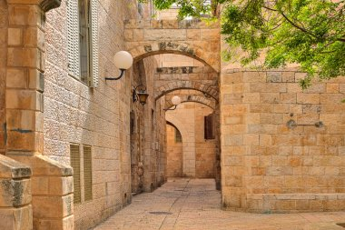 Narrow street and stonrd houses at jewish quarter in Jerusalem.