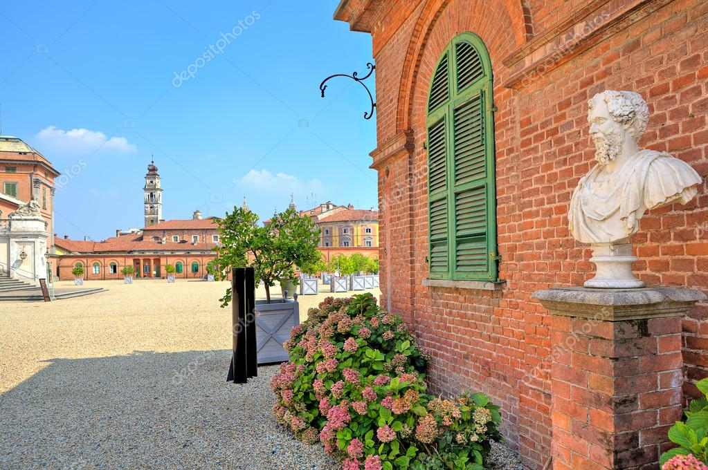 Bust On Pedestal On The Gravel Pathway Next To Red Brick House At The  Entrance To Park And Royal Castle Of Racconigi In Piedmont, Northern Italy.