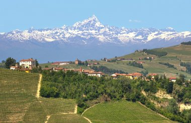 Small village and mountain peak on background in Italy.